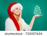 enjoying cozy holiday interior  ... | Shutterstock . vector #720357634