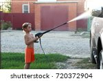 child washing car with high...   Shutterstock . vector #720372904