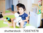 cute child playing indoors   Shutterstock . vector #720374578