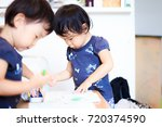 cute child playing indoors   Shutterstock . vector #720374590