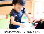 cute child playing indoors   Shutterstock . vector #720375478