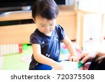 cute child playing indoors   Shutterstock . vector #720375508