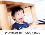 cute child playing indoors   Shutterstock . vector #720375538