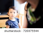 cute child playing indoors   Shutterstock . vector #720375544
