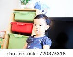cute child playing indoors   Shutterstock . vector #720376318