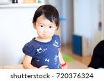 cute child playing indoors   Shutterstock . vector #720376324