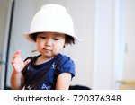 cute child playing indoors   Shutterstock . vector #720376348