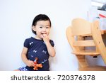 cute child playing indoors   Shutterstock . vector #720376378