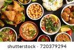 assorted lebanese mezze | Shutterstock . vector #720379294