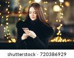 winter beautiful woman city... | Shutterstock . vector #720386929