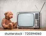 teddy bear toy watching retro... | Shutterstock . vector #720394060
