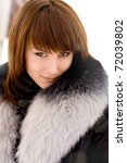 young beautiful girl in a fur collar - stock photo