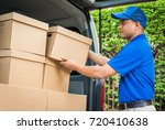blue delivery man pick up the... | Shutterstock . vector #720410638