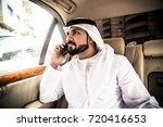 arabic man in his luxury car   Shutterstock . vector #720416653