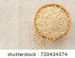 quinoa in bowl  from top view... | Shutterstock . vector #720434374