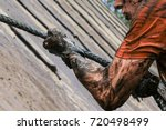 mud race runners  defeating... | Shutterstock . vector #720498499