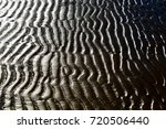sandy beach and drawings left... | Shutterstock . vector #720506440