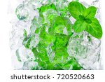 fresh mint leaves on ice cubes... | Shutterstock . vector #720520663
