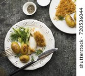 cod baked with garlic bread... | Shutterstock . vector #720536044