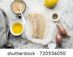 cod fillets with melted butter... | Shutterstock . vector #720536050