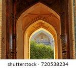 bukhara  entrance to madrasah | Shutterstock . vector #720538234