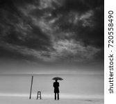 Lonely Man With Umbrella...