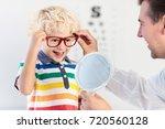 child at eye sight test. little ... | Shutterstock . vector #720560128