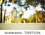 ice lemonade half a glass   Shutterstock . vector #720571156