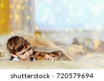 cute baby embracing and... | Shutterstock . vector #720579694
