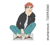 boy with a sad face sits on the ... | Shutterstock .eps vector #720592060