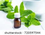 bottle of essential mint oil... | Shutterstock . vector #720597544