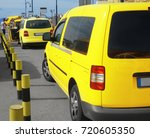bright yellow taxi cabs in... | Shutterstock . vector #720605350