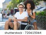 handicapped man in wheelchair... | Shutterstock . vector #720615064