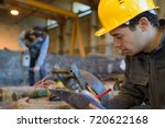 worker in the factory writing... | Shutterstock . vector #720622168