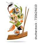 sushi pieces placed between... | Shutterstock . vector #720624610