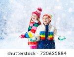 kids playing in snow. children... | Shutterstock . vector #720635884