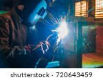 the worker in overalls and a...   Shutterstock . vector #720643459