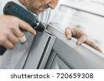manual worker assembling pvc... | Shutterstock . vector #720659308