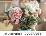 young woman florist occupation...   Shutterstock . vector #720677086