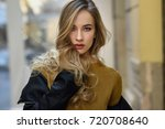 blonde woman in urban... | Shutterstock . vector #720708640
