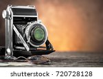 old camera | Shutterstock . vector #720728128