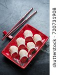 Small photo of Steamed chinese har gao over gray stone background, vertical shot, elevated view