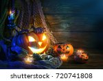 halloween pumpkins on a wooden... | Shutterstock . vector #720741808