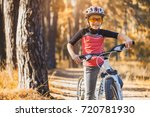 kid on a bicycle in the sunny... | Shutterstock . vector #720781930