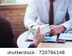 hand giving money   united...   Shutterstock . vector #720786148