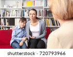 young mother and little boy on... | Shutterstock . vector #720793966