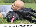 man with black dog in the park... | Shutterstock . vector #720797713