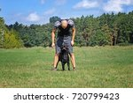 man running with dog in the... | Shutterstock . vector #720799423