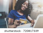 happy young african american... | Shutterstock . vector #720817339