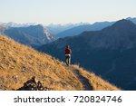 hiker in high altitude rocky... | Shutterstock . vector #720824746